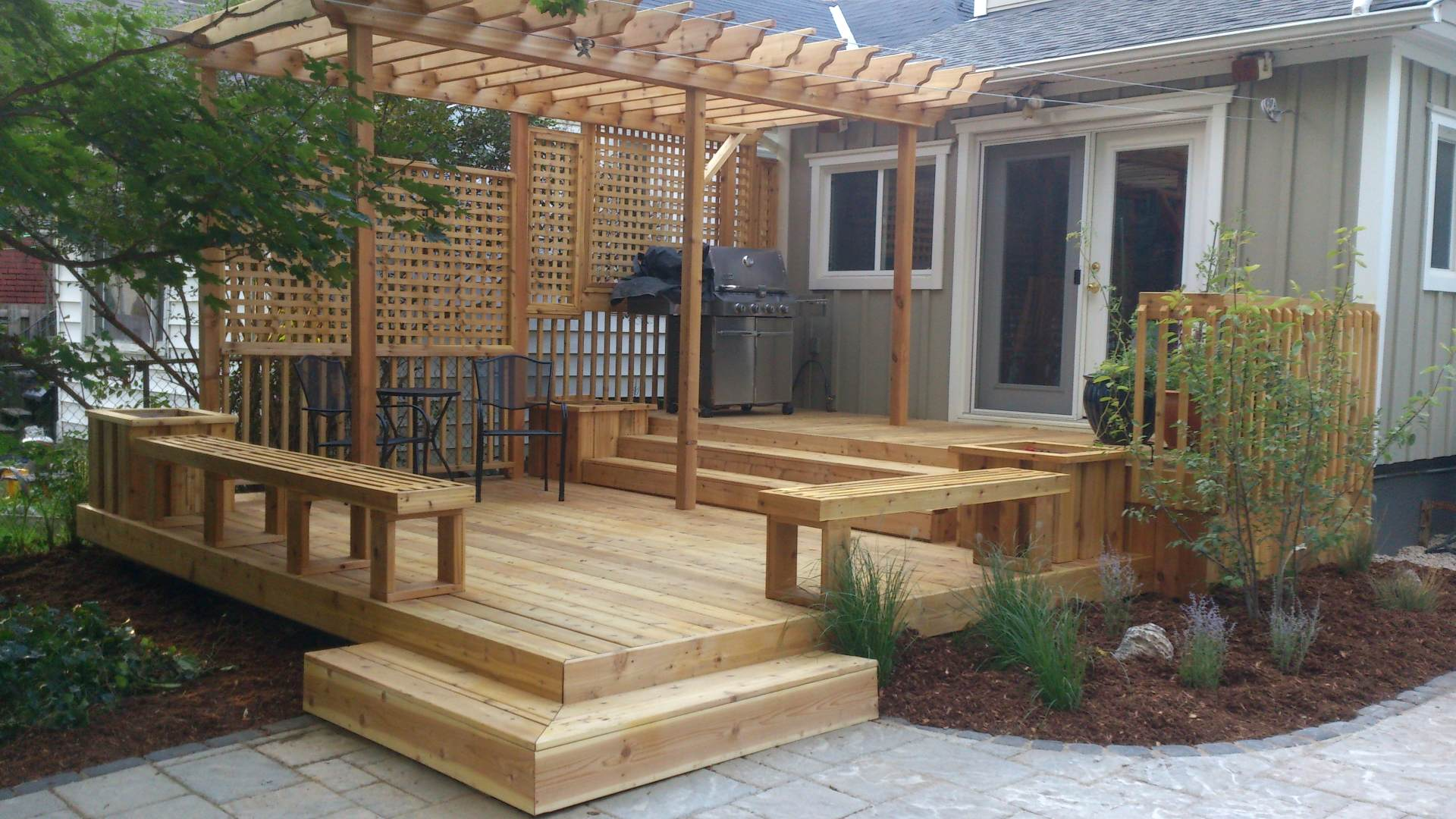 New deck and backyard renovation: a landscaping, hardscaping and woodwork project in London Ontario.