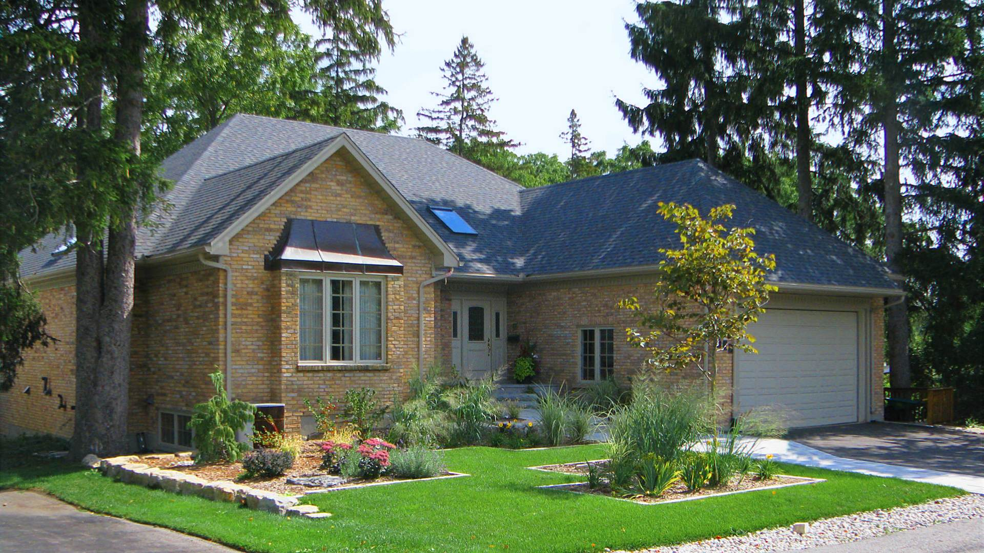 Front lawn landscaping and landscape redesign project in London Ontario.