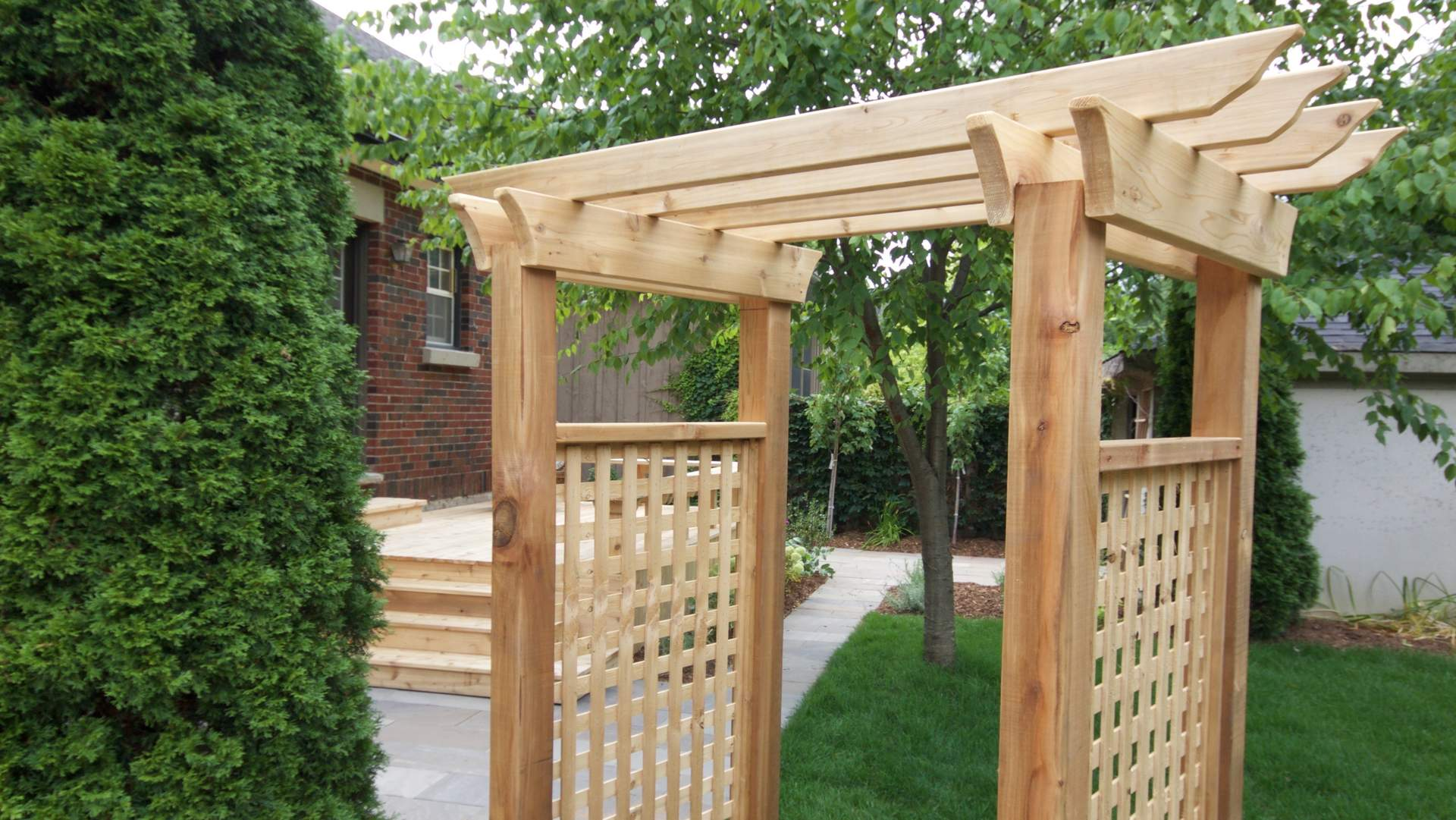 Arbour. Woodwork and deck in the background. Modern landscaping / hardscaping project in London Ontario.