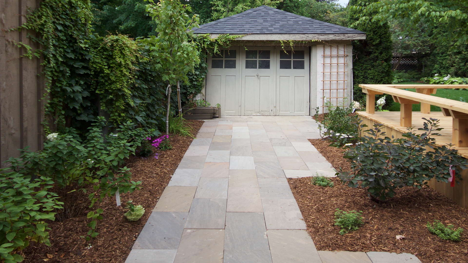 Stone slab driveway and landscape. Modern landscaping project in London Ontario.