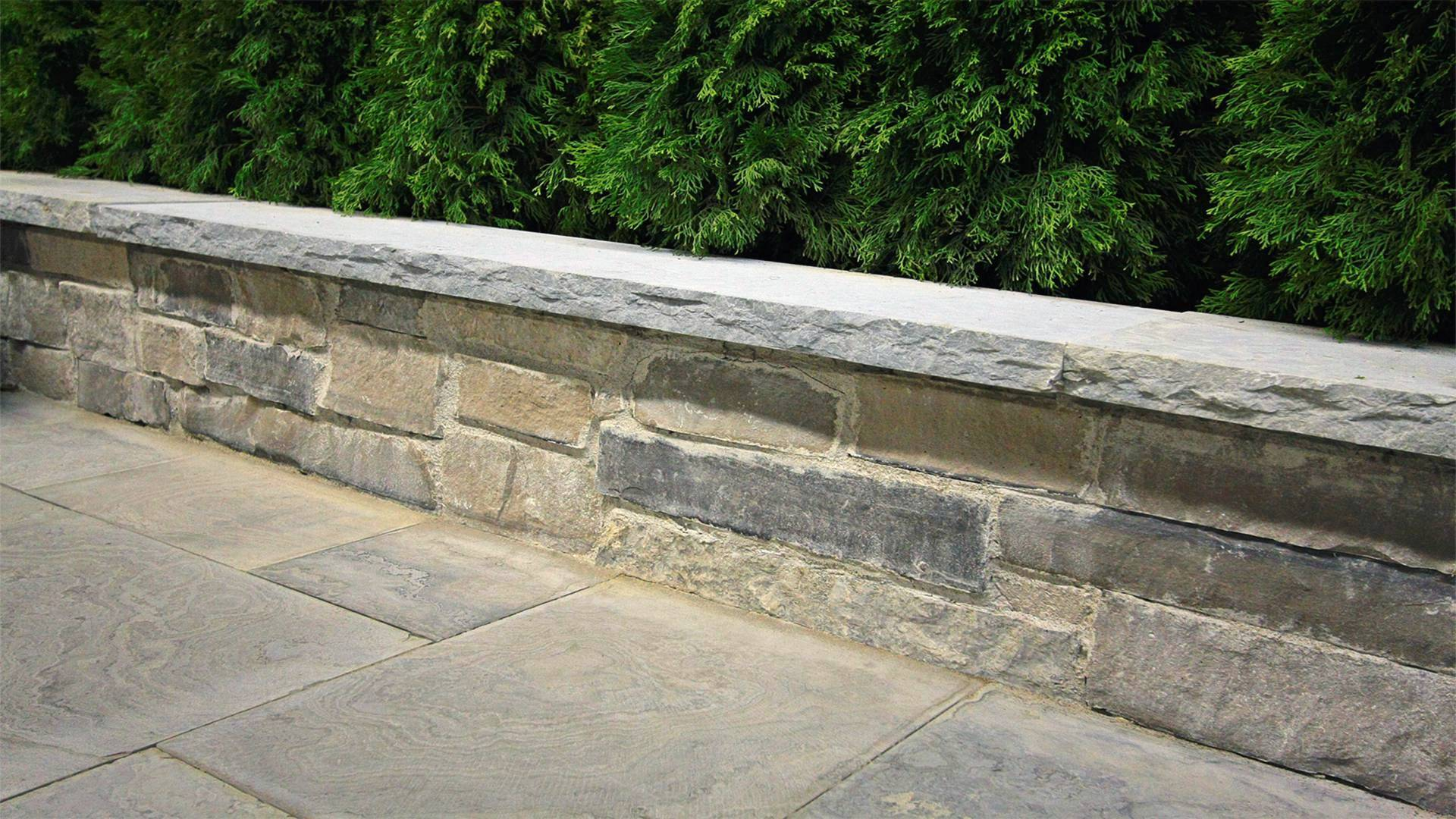 Traditional stonework / hardscaping project in London Ontario. A retaining wall.