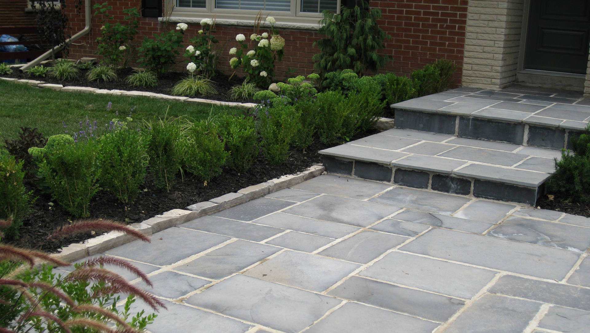 Stone steps and front yard landscaping. Modern landscaping / hardscaping project in London Ontario.